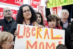 Supporter of Liberal Leader Michael Ignatieff holding a sign